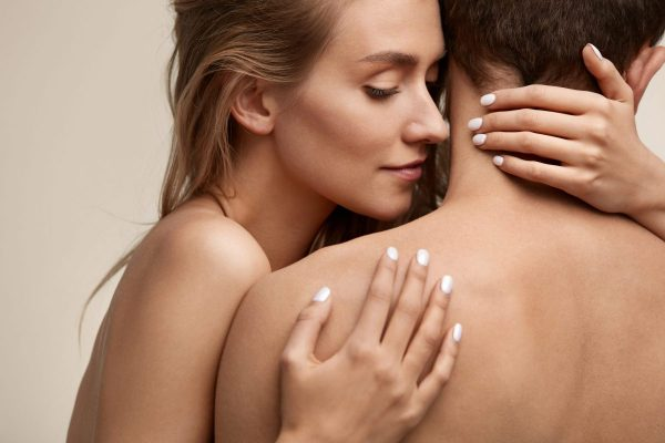 Sweet Couple In Love. Closeup Of Beautiful Sexy Young Woman With Perfect Natural Makeup Embracing Man With Hands, Smelling Pure Smooth Soft Clean Neck Skin. Body Cosmetics Concept. High Resolution